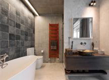 The bathroom is similarly simple and it too has warm wood accents and touches of color