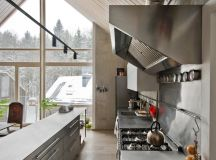 The kitchen also has an industrial hood which emphasizes the tendency for professionalism