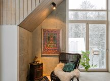 There's a cozy little nook in this corner, framed by the sloped ceiling and with a nice view