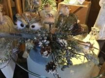 Made from natural materials, the owl is an adorable addition to the arangement.