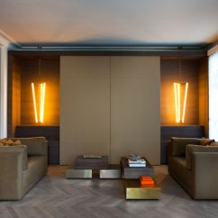 Hiding Tv In Living Room With Sofa And Two Accent Chairs Modern Ways To Seamlessly Hide The