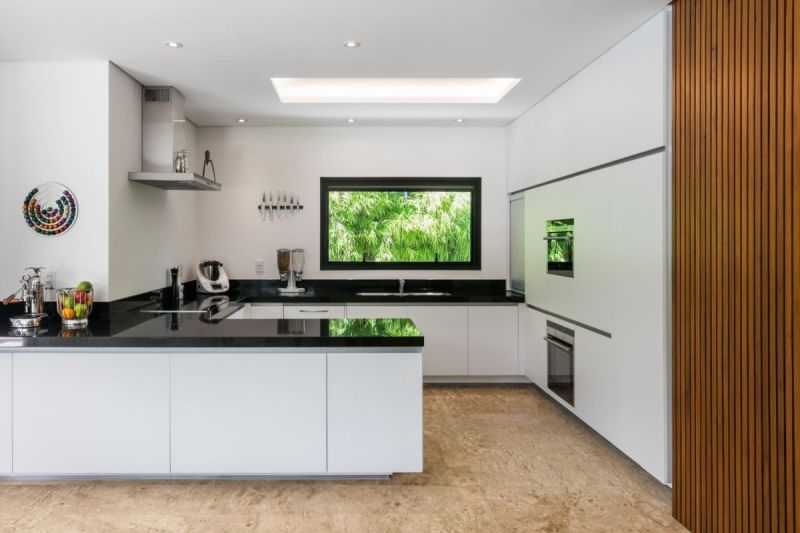 The kitchen window is small compared to the others but the space compensates for that with a skylight