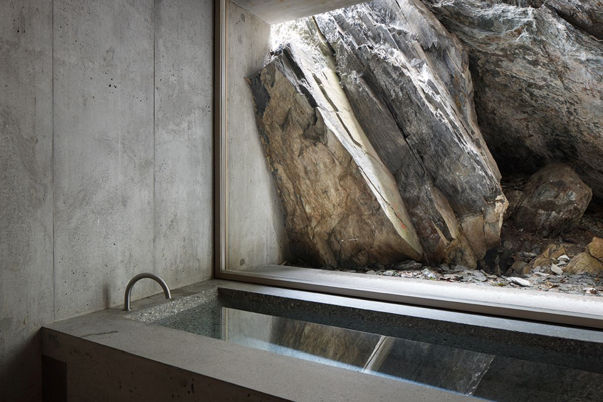Concrete bathroom design with large window to a boulder  Home Decorating Trends  Homedit