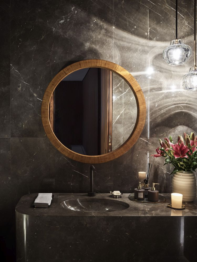 Dark marble surfaces give the bathrooms a very elegant and glamorous appearance