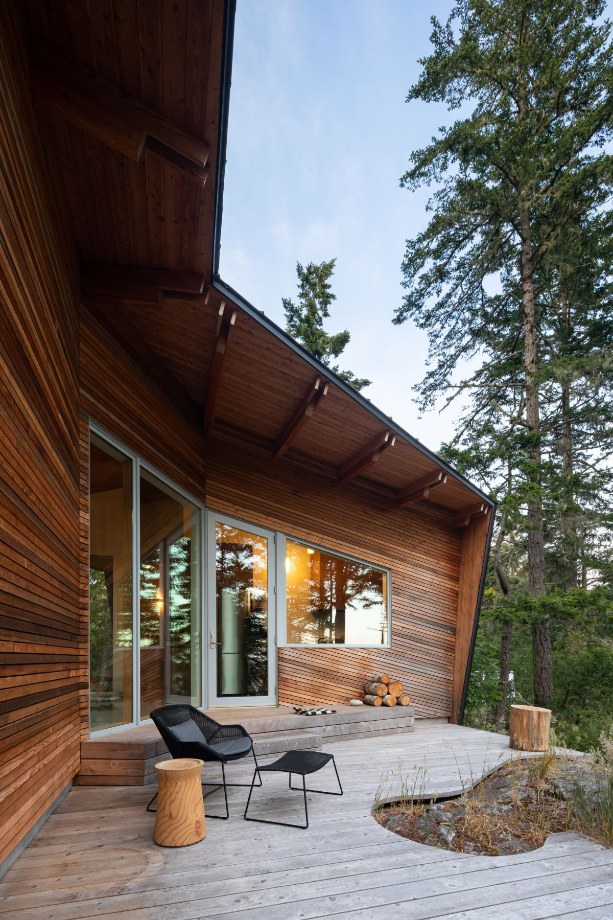 The interior areas are organized around the social spaces and extend out onto a small wooden deck