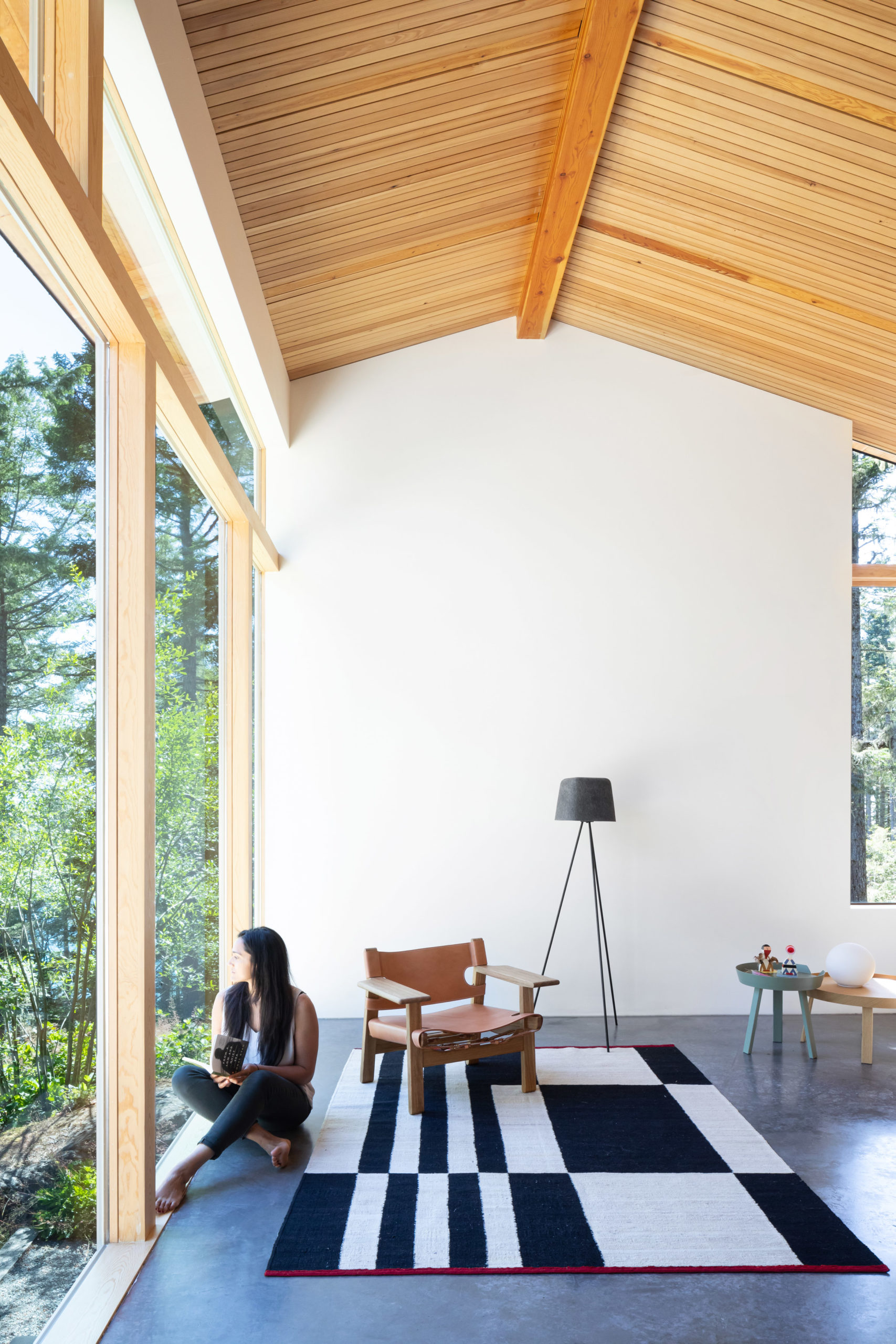 Most the of the walls inside the house are white which looks very clean and stylish in combination with the wooden ceilings