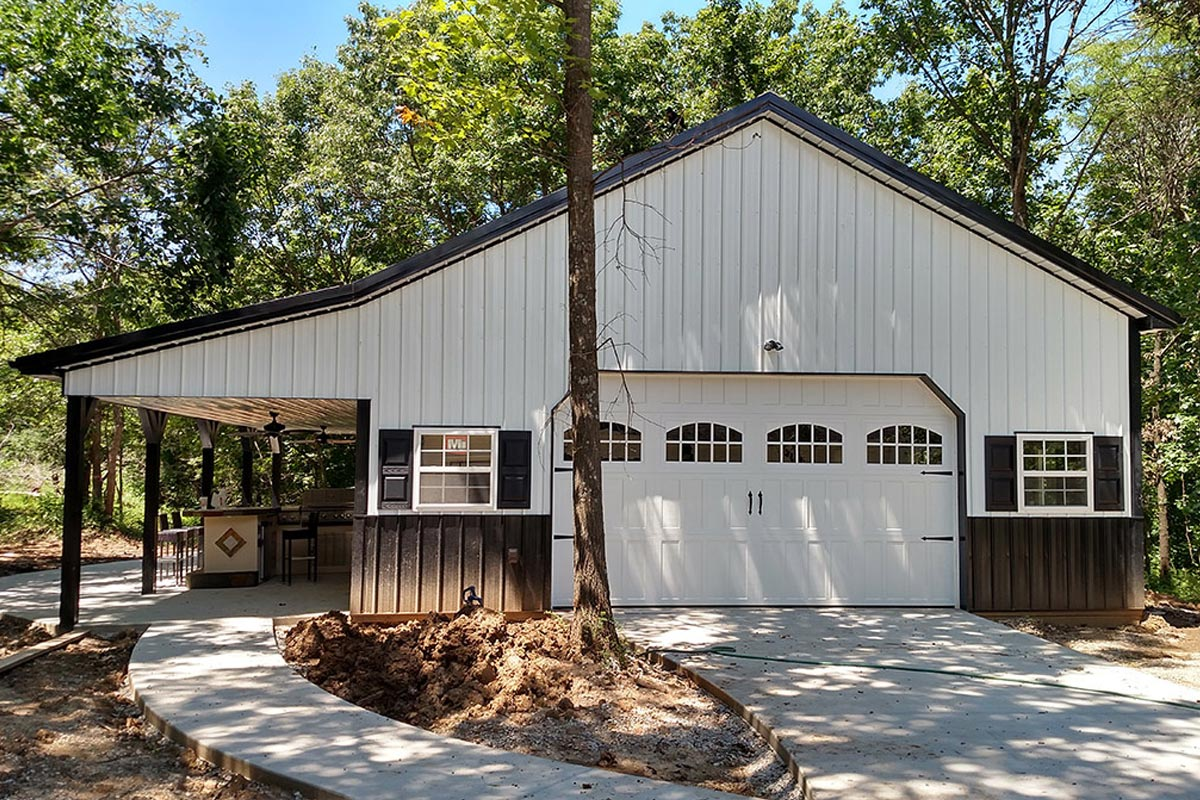 hight resolution of pole barn house built on concrete slab with 2 car garage and lean to