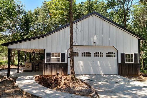 small resolution of pole barn house built on concrete slab with 2 car garage and lean to