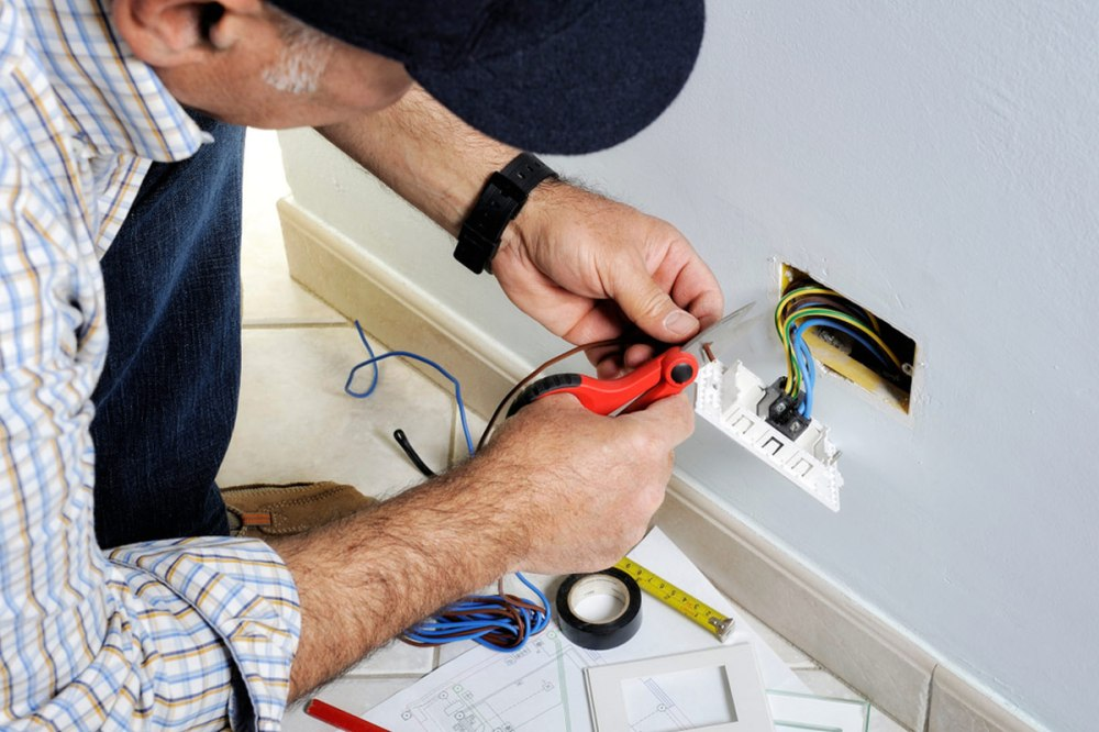 medium resolution of electrician rewiring and installing new outlet