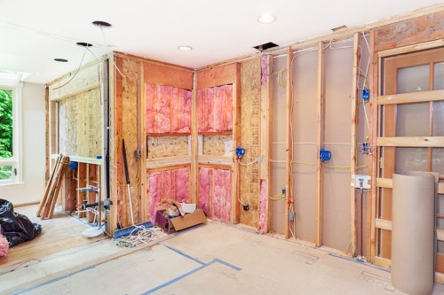 small resolution of electrician works to rewire a house for remodeling