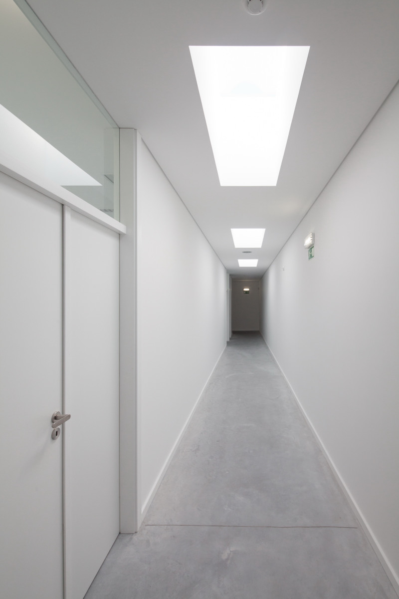 Minimalist Private College Designed by OVAL Exudes