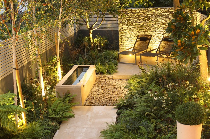 Backyard Landscaping Ideas Dense Greenery Complemented By A Rock