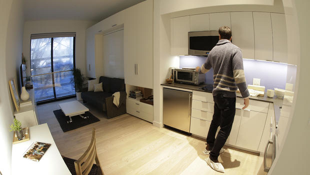 One Room Fits All In A Small White Efficiency Apartment