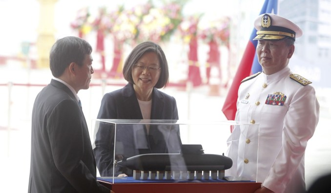 Taiwan President Tsai Ing-wen inspects the model of the island's first indigenous submarine at Thursday's ceremony. Photo: AP