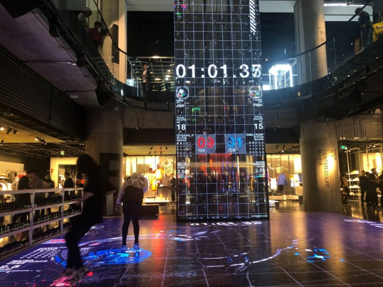 Customers play games in Nike's new flagship store on Nanjing East Road, one of Shanghai's most robust shopping districts. Photo: Pearl Liu