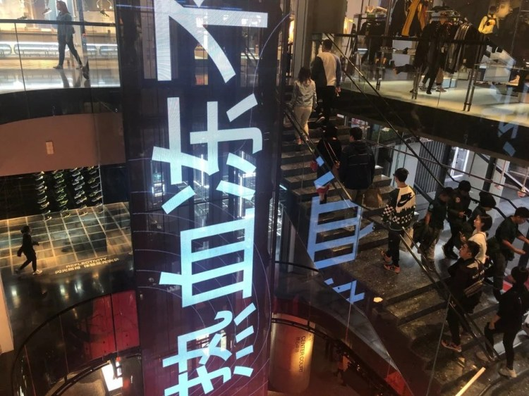 Customers heading up the stairs at Nike's four-storey flagship store on Nanjing East Road, one of Shanghai's most robust shopping district. Photo: Pearl Liu
