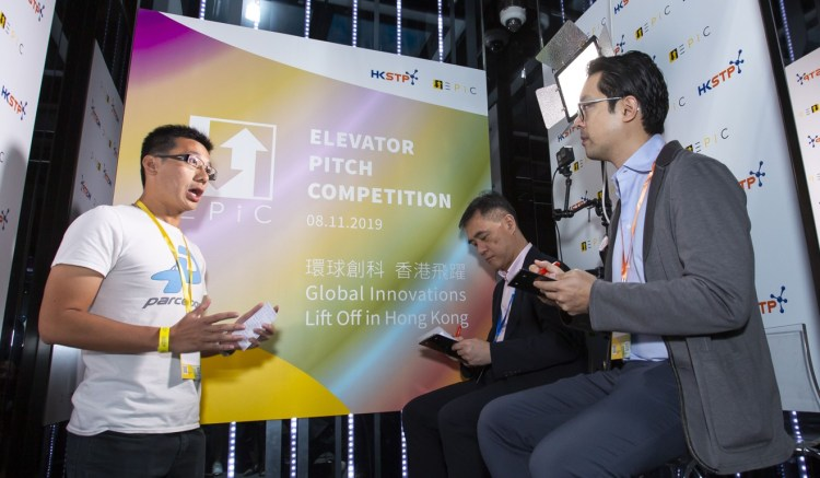 Joseph Fung (far right), managing partner of Saltagen Ventures, was one of the judges listening to business pitches by start-up entrepreneurs at November's Elevator Pitch Competition. Photo: Frank Freeman
