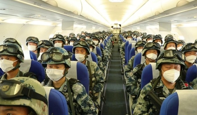 State media aired footage of troops boarding civilian planes to get from Hubei province to the unspecified location thousands of kilometres away. Photo: Weibo
