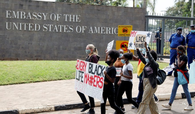 Demonstrators bearing placards march past the US embassy in Nairobi on Tuesday. Photo: Reuters