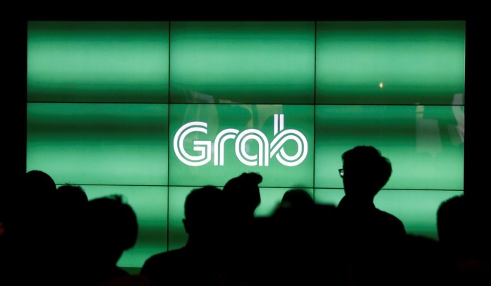 Grab, Southeast Asia's highest-valued private tech firm, is considering a US listing. Photo: Reuters