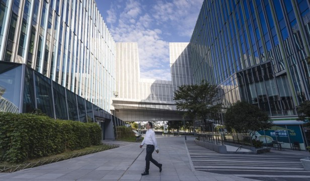 The Sinic Holdings Group headquarters in Shanghai. On Monday, the company said it did not expect to pay a US$250 million bond due next week. Photo: EPA-EFE