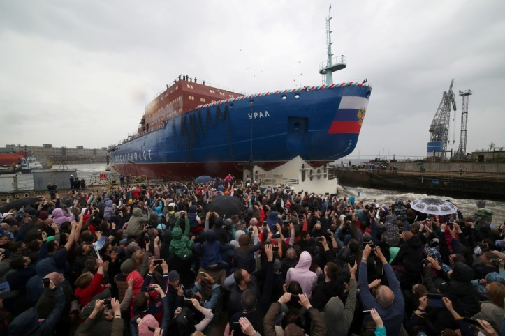 People attend the float out ceremony of the nuclear-powered icebreaker Ural at the Baltic Shipyard in St. Petersburg, Russia, on Saturday. Photo: Reuters