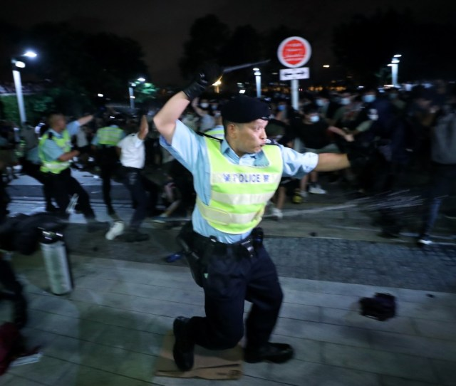 Hong Kong Police Use Batons And Pepper Spray On Protesters At The Legislative Council Complex In
