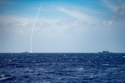 The guided-missile destroyer USS Barry (left) launches a missile during a live-fire exercise on Thursday. Photo: US Navy