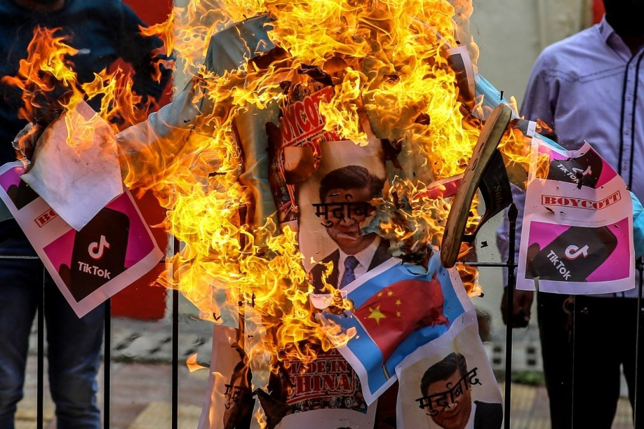 BJP members burn an effigy of Xi Jinping during a protest against China in Mumbai on June 19. China's reputation among Indians had been battered by the border dispute. Photo: EPA-EFE