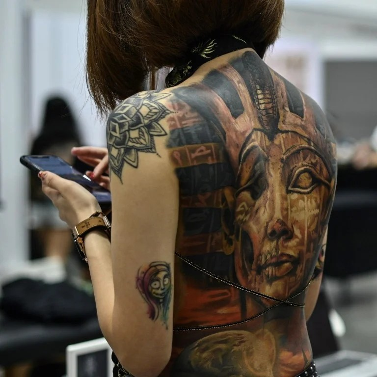 Half Naked Parades At Malaysia Tattoo Show Leave