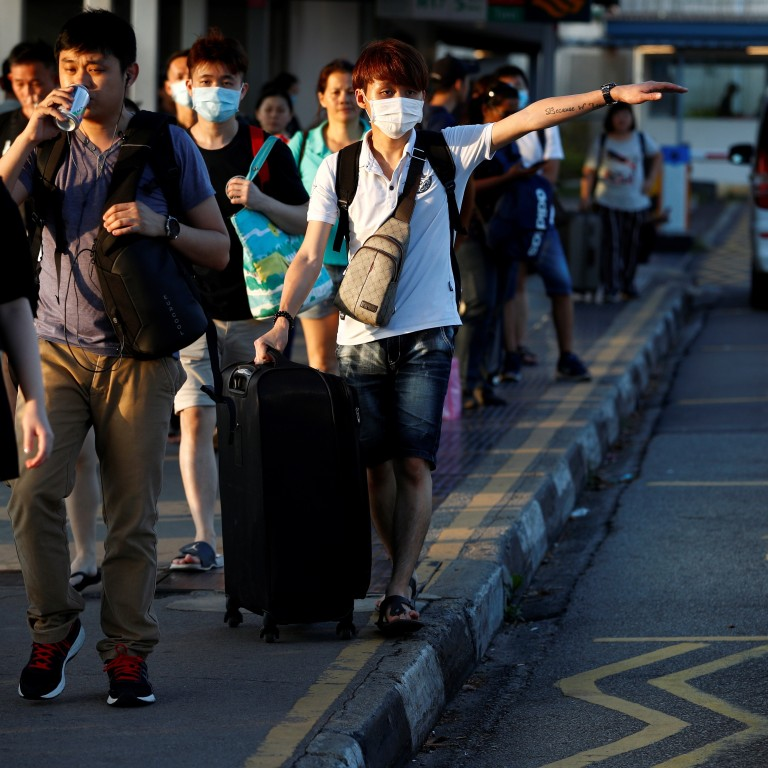 Coronavirus: Singapore scrambles to house commuting workers after ...