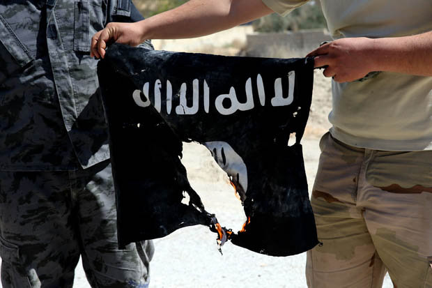 Burning ISIS flag