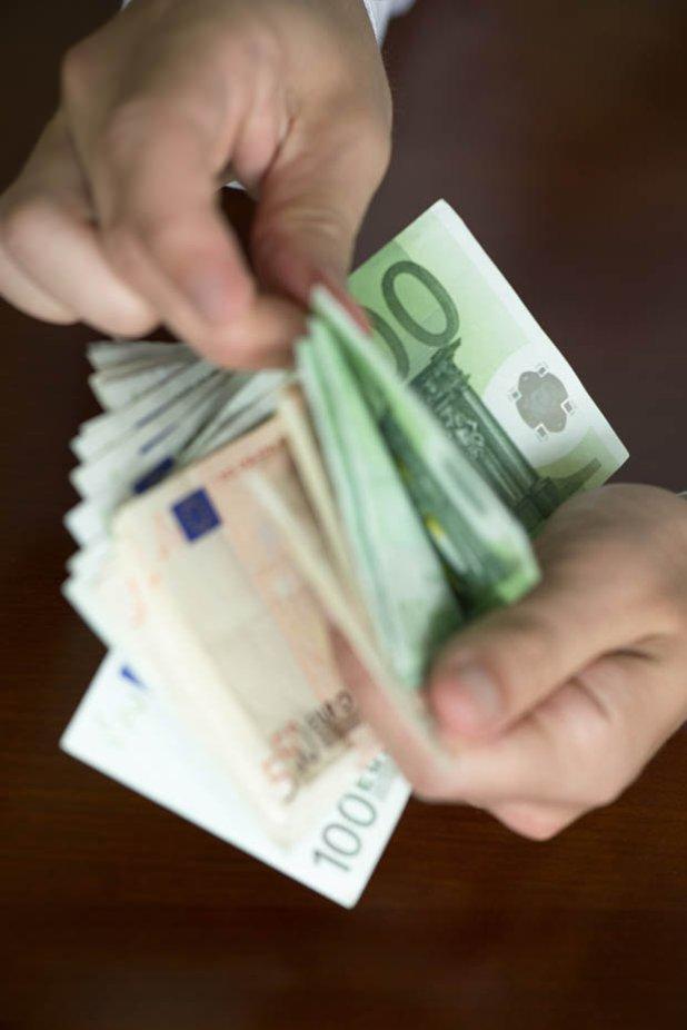 Man holding Euros