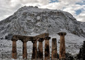 Snow covers Greek ruins.