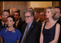 Senior advisor Steve Bannon (C) stands between U.S. Deputy National Security Advisor for Strategy Dina Powell (L) and Ivanka Trump e in West Palm Beach
