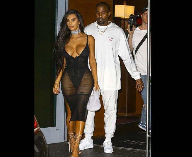 Kim Kardashian is pictured in a sheer dress