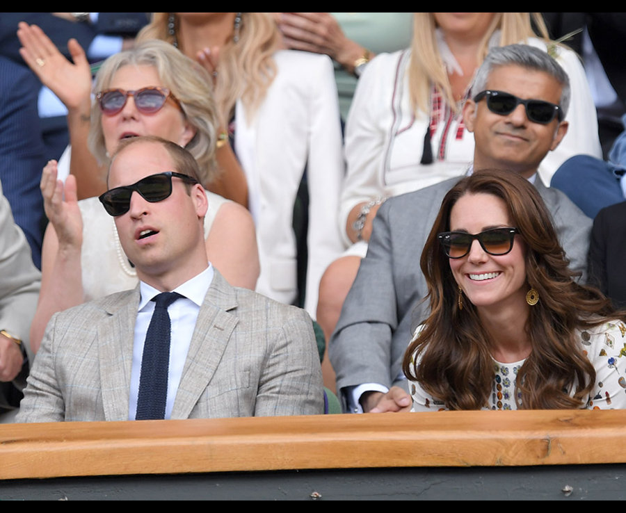 Chilling at Wimbledon with his wife