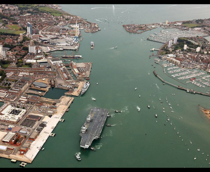 An aerial view of the HMS Queen Elizabeth arriving into Portsmouth
