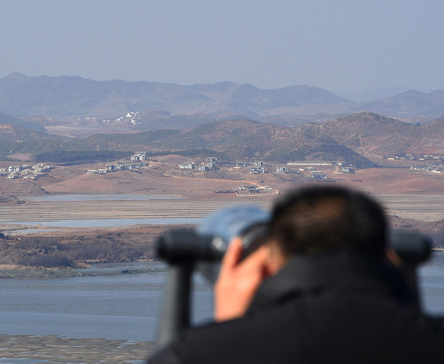 A South Korean peers through a telescope