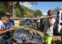 Local ecological association members carry debris found on France's Sainte-Suzanne on Reunion island - August, 2015.