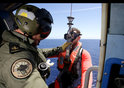 Royal Australian Navy winch a aircrewman into the water to search for an sign of MH370 - April, 2014.