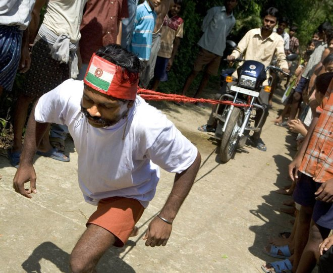 Siba Prasad Mallick, 34, demonstrates his super human strength by pulling three motorcycles with his moustache