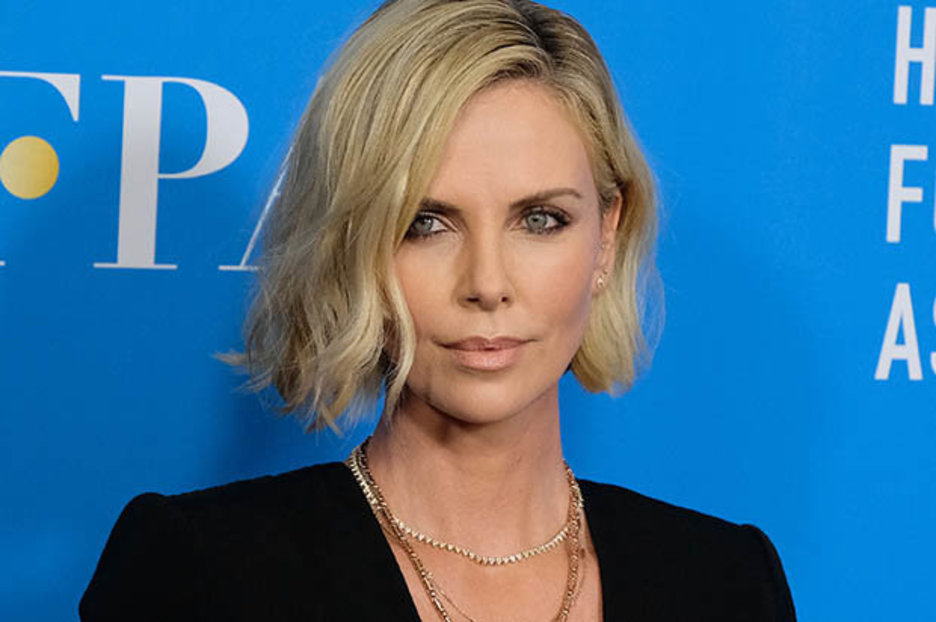 Charlize Theron 43 Sizzles In Black Dress Slashed To