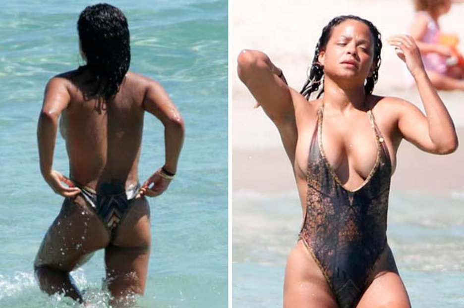 Christina Milian reveals nipple as she takes a dip in the