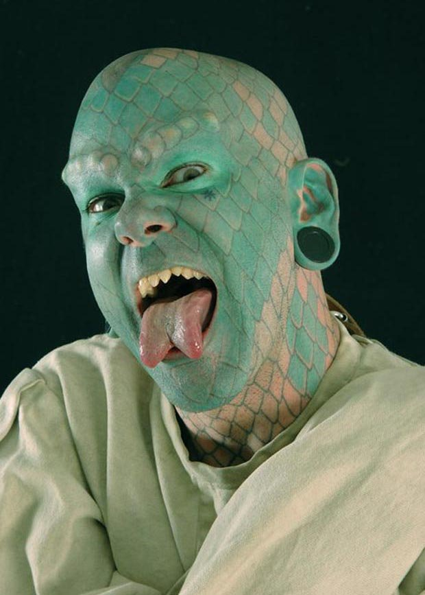 Lizard man had 700 hours of tattoos to create his extreme look