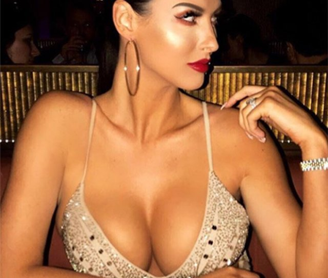 Alice Goodwin Poses In A Low Cut Dress At The Dining Table