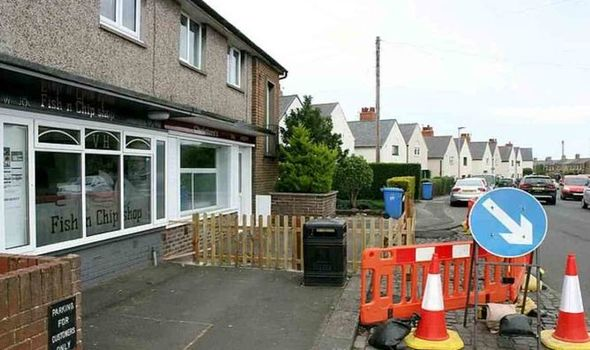 Couple 'shot at' after building fence to stop chip shop customers eating on windowsill