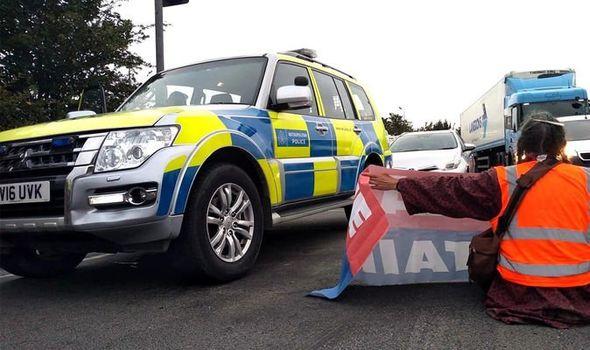 Brazen Insulate Britain walk in front of POLICE CAR to block M25 junction