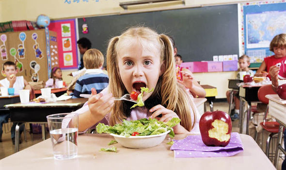 A girl eating salad in the classroom