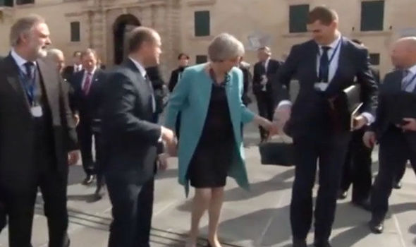 The Prime Minister left a senior civil servant red-faced as she passed him her handbag